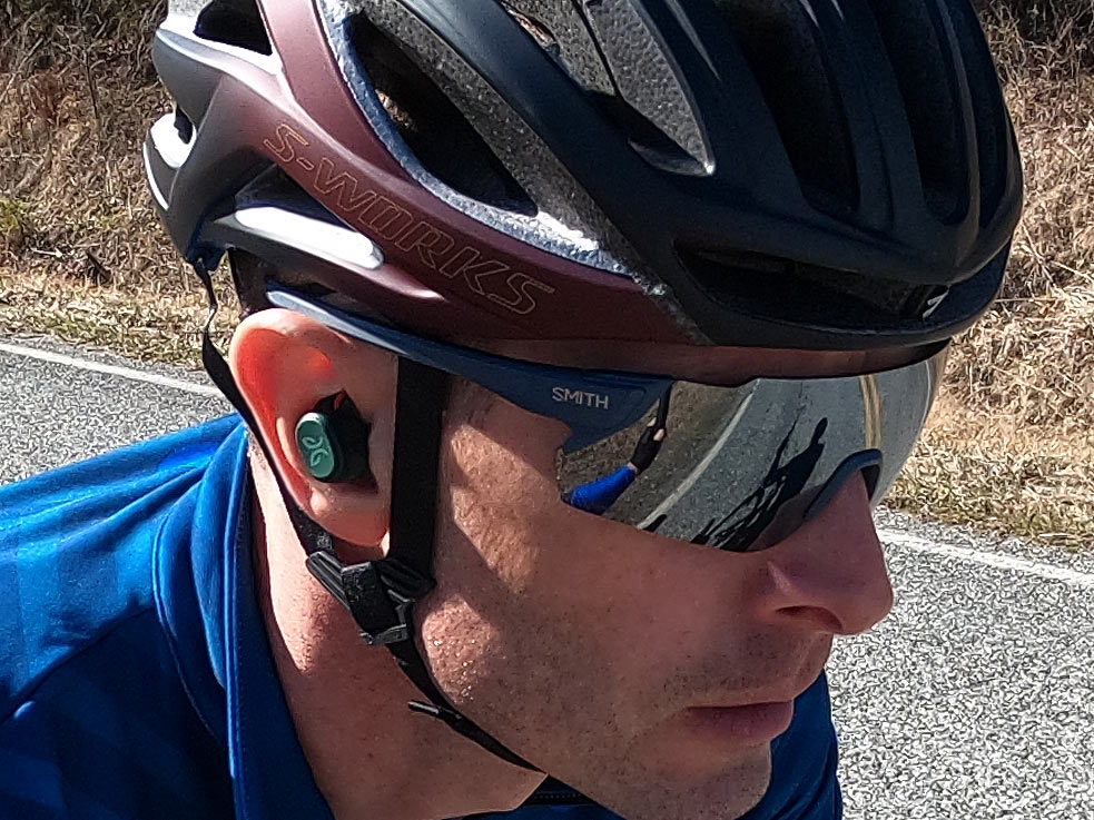 jaybird vista pro wireless earbuds for cyclists shown on a rider