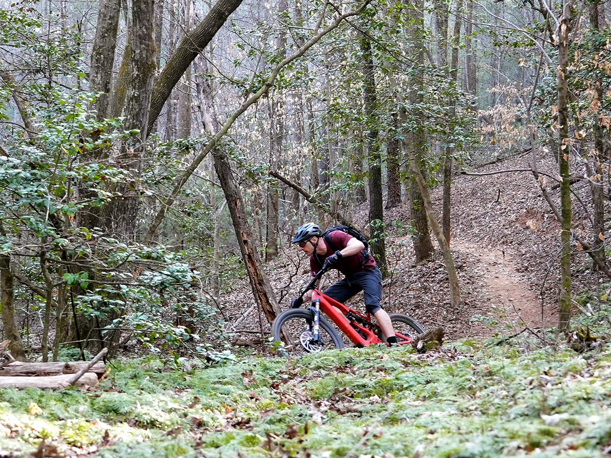 specialized turbo levo 3 riding in the woods on singletrack