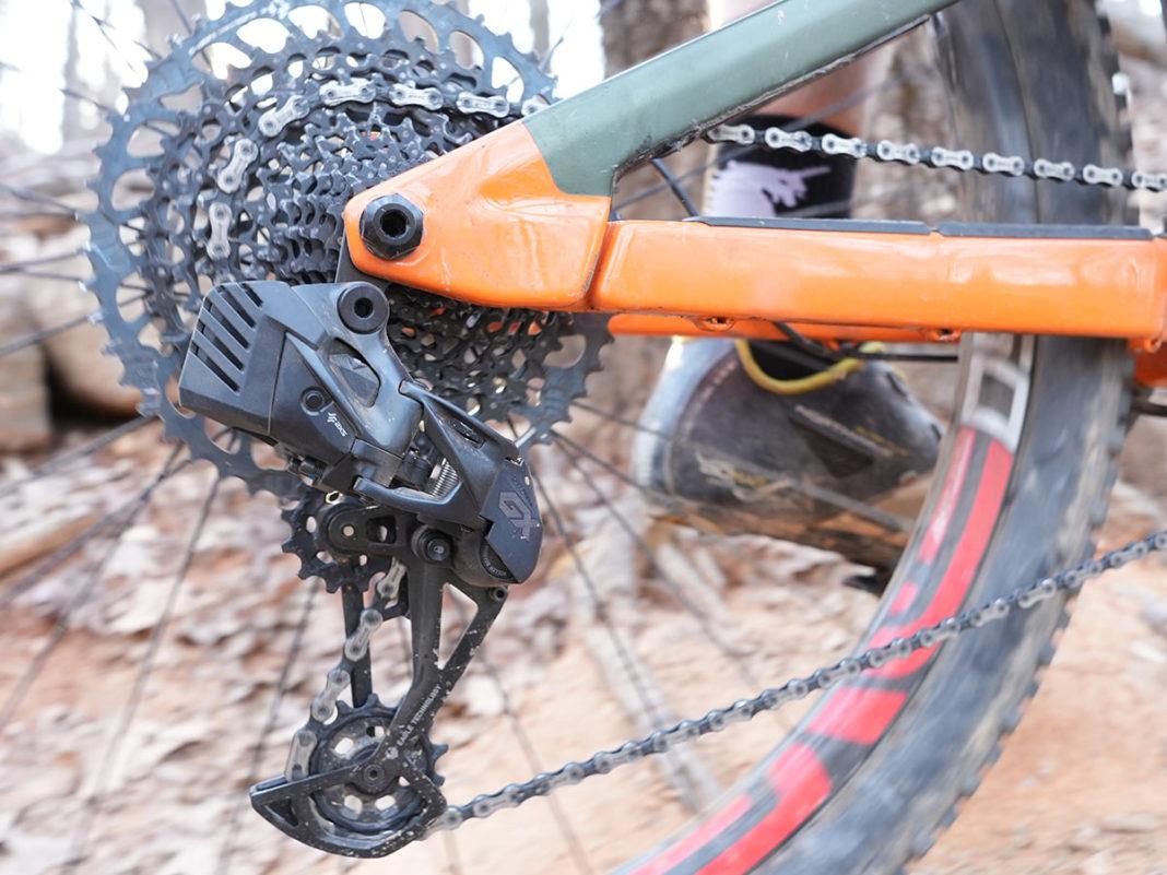 sram gx eagle axs wireless rear derailleur shown on a mountain bike while riding