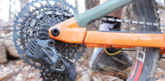 sram gx eagle axs wireless rear derailleur shown on a mountain bike while riding