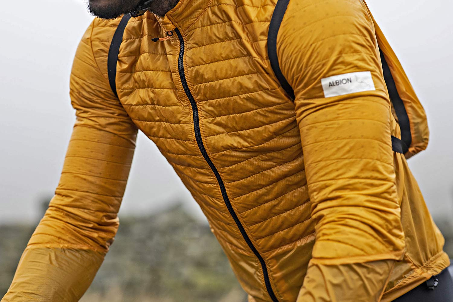 Albion Ultralight Insulated Jacket, ultra lightweight packable breathable eco cycling jacket and backpack, detail up close