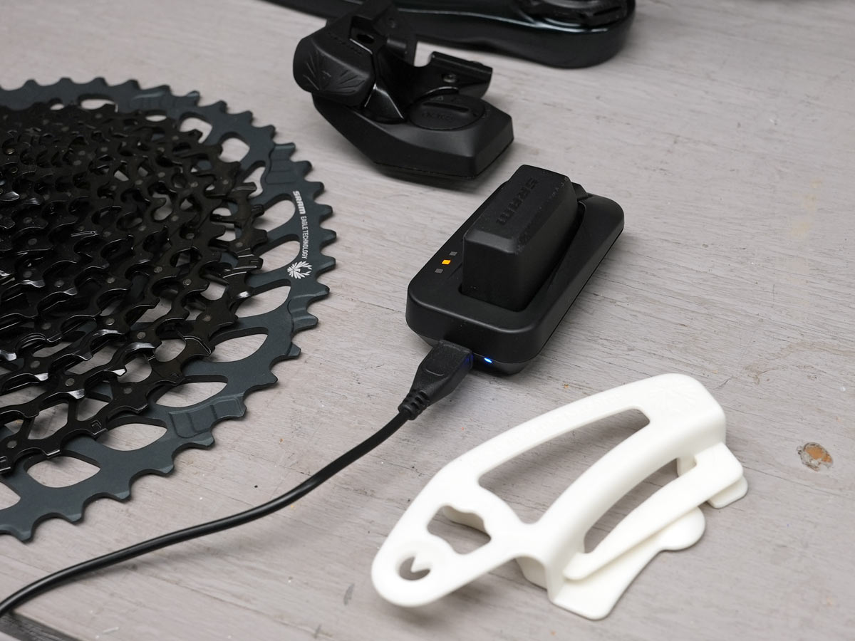 sram gx eagle axs comparison and upgrade kit components shown on a workbench