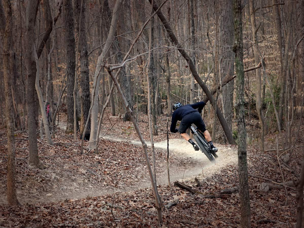 litespeed pinhoti 3 titanium mountain bike riding away on a beamed corner