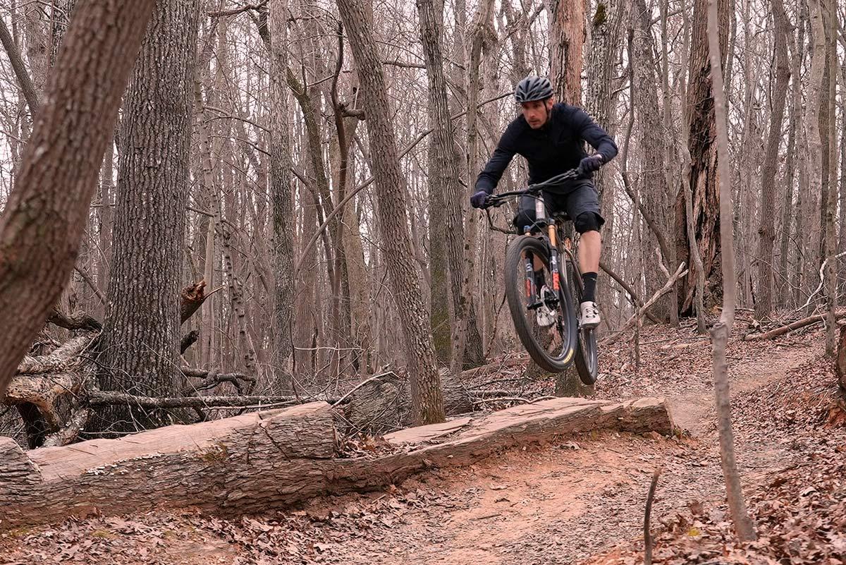 litespeed pinhoti 3 titanium mountain bike jumping over a log ramp