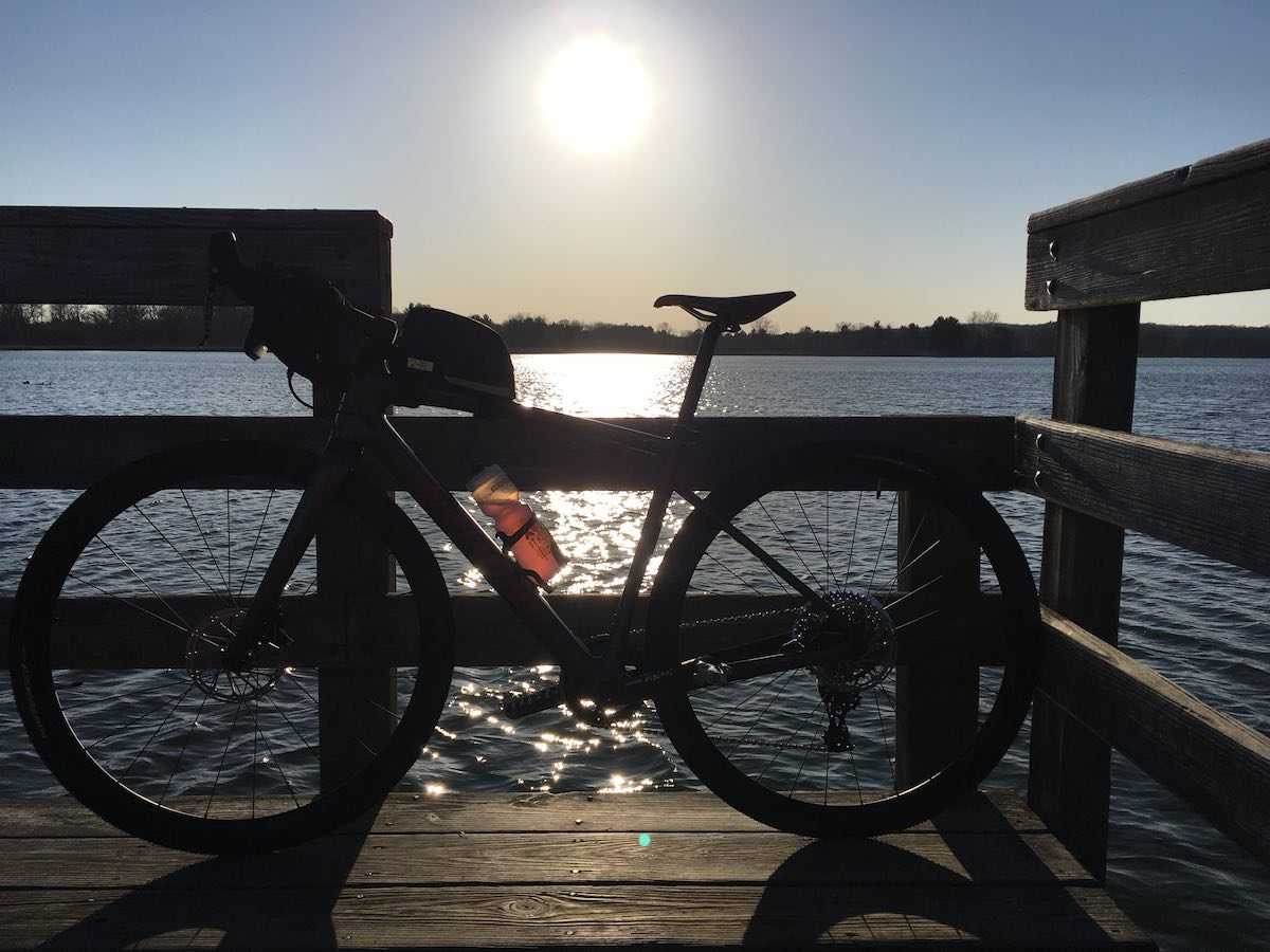 bikerumor pic of the day a bicycle is on the end of a pier and is photographed with the sun in the background so that the bike is in profile.