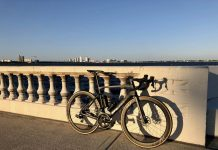 bikerumor pic of the day a fuji transonic 1.1 on bayshore boulevard in tampa the light is low in the evening and lighting up the concrete wall along the shore with the city in the background.