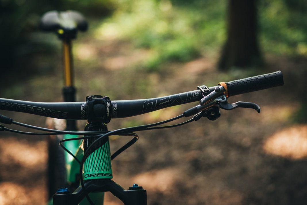 Race Face Next SL carbon handlebar shown on a mountain bike