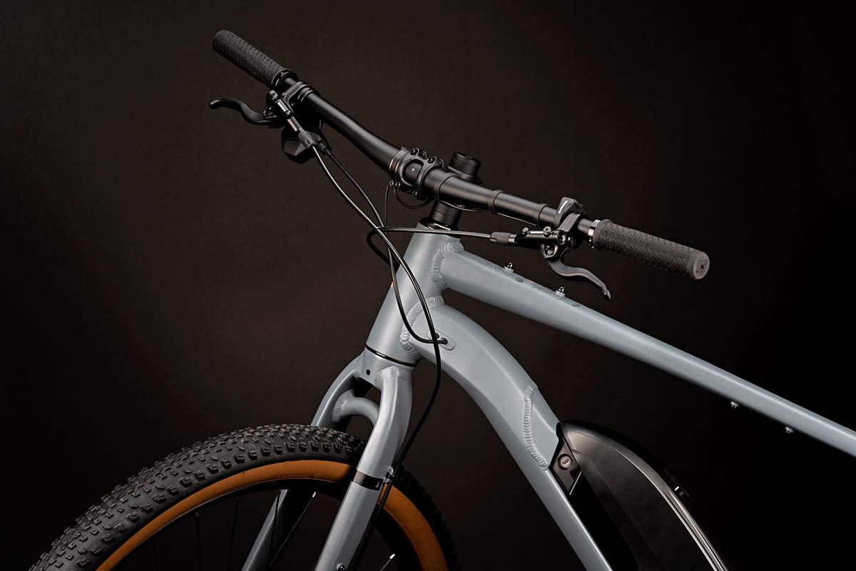 Cairn Brave adventure e-bike, rigid alloy off-road gravel bikepacking mountain eMTB,flat bar detail