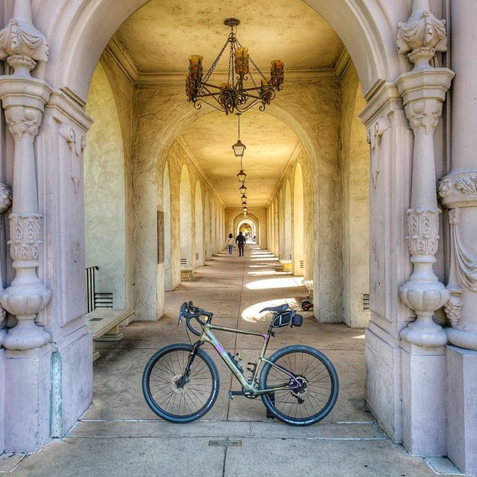 a bicycle sits in the entry way of an ornate balboa park in san diego california.