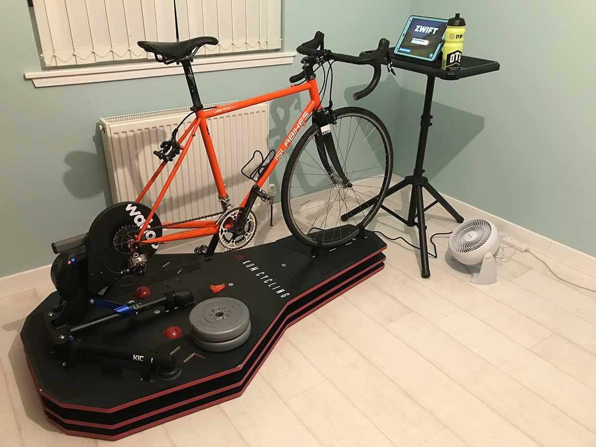 complete indoor taining setup kom full motion rocker plate rpv2 wahoo kickr isla bikes steel road bike media display zwift