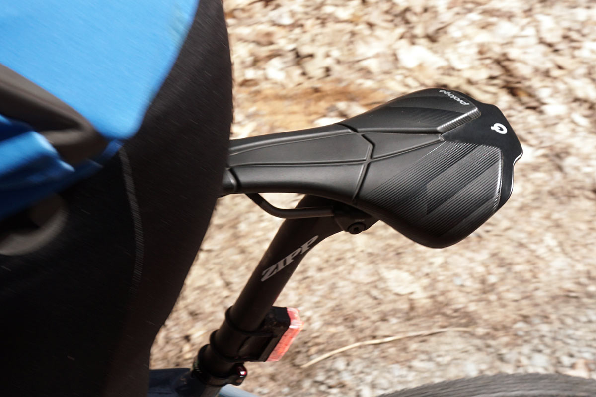 prologo scratch M5 AGX saddle shown on a bike being ridden over gravel roads