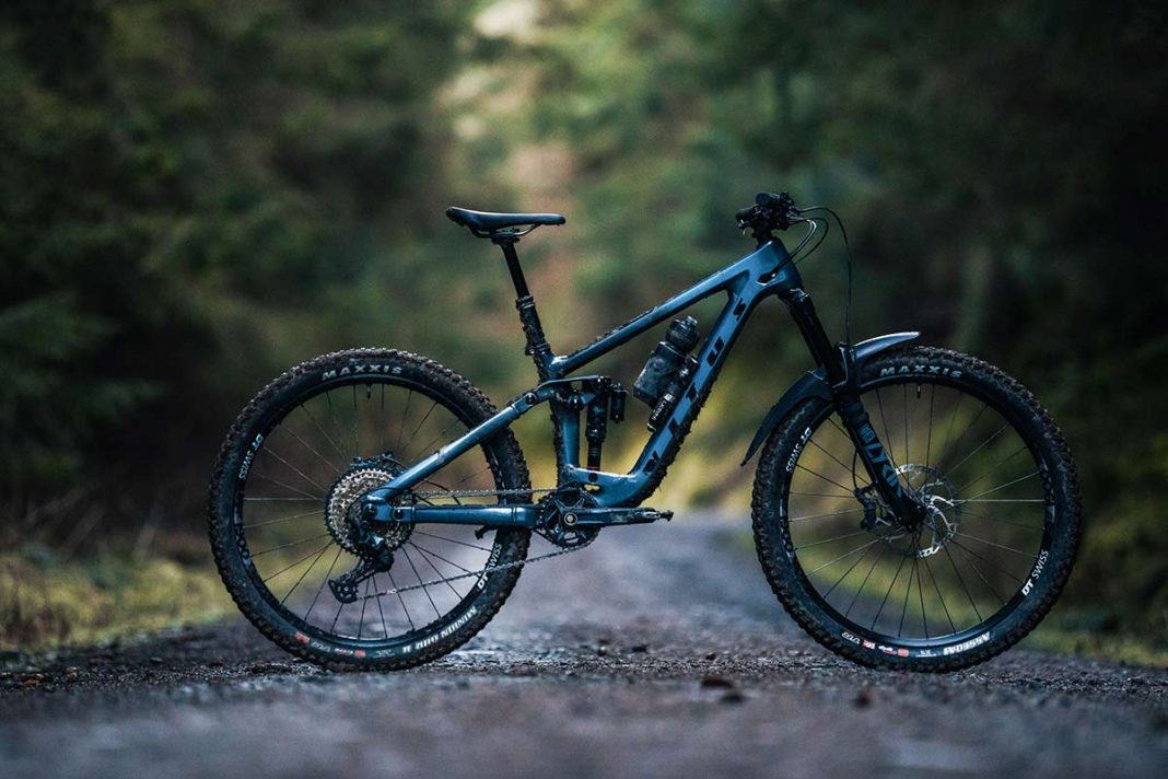 2021 vitus sommet crs review complete bike picture forest road background