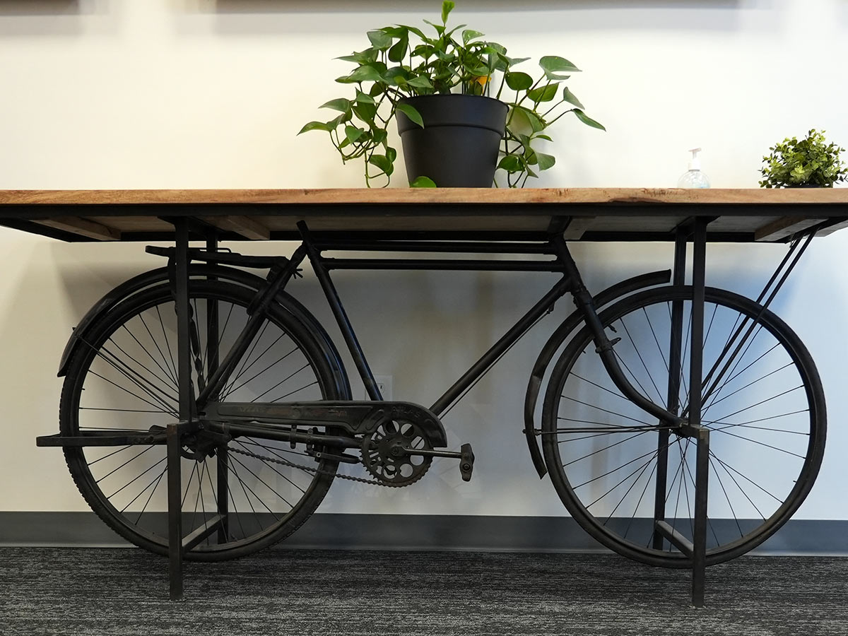 table with a classic bicycle as legs