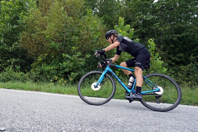 felt vr advanced endurance road bike racing through a corner