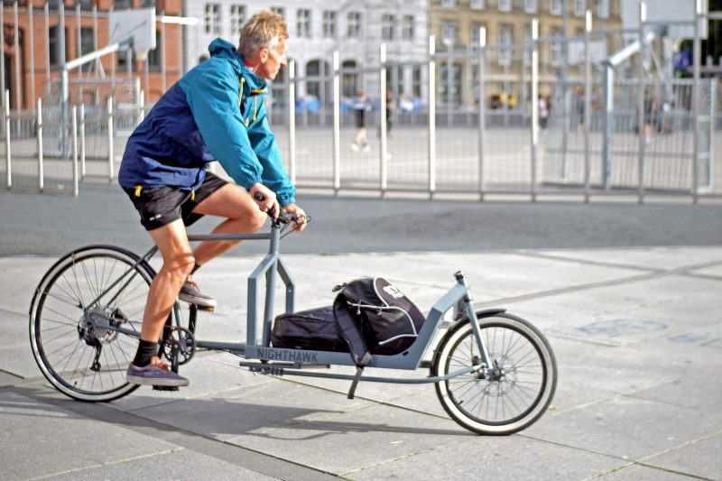 KP Cyclery Nighthawk steel cargo bike, affordable EU-made customizable long john cargo bikes,riding