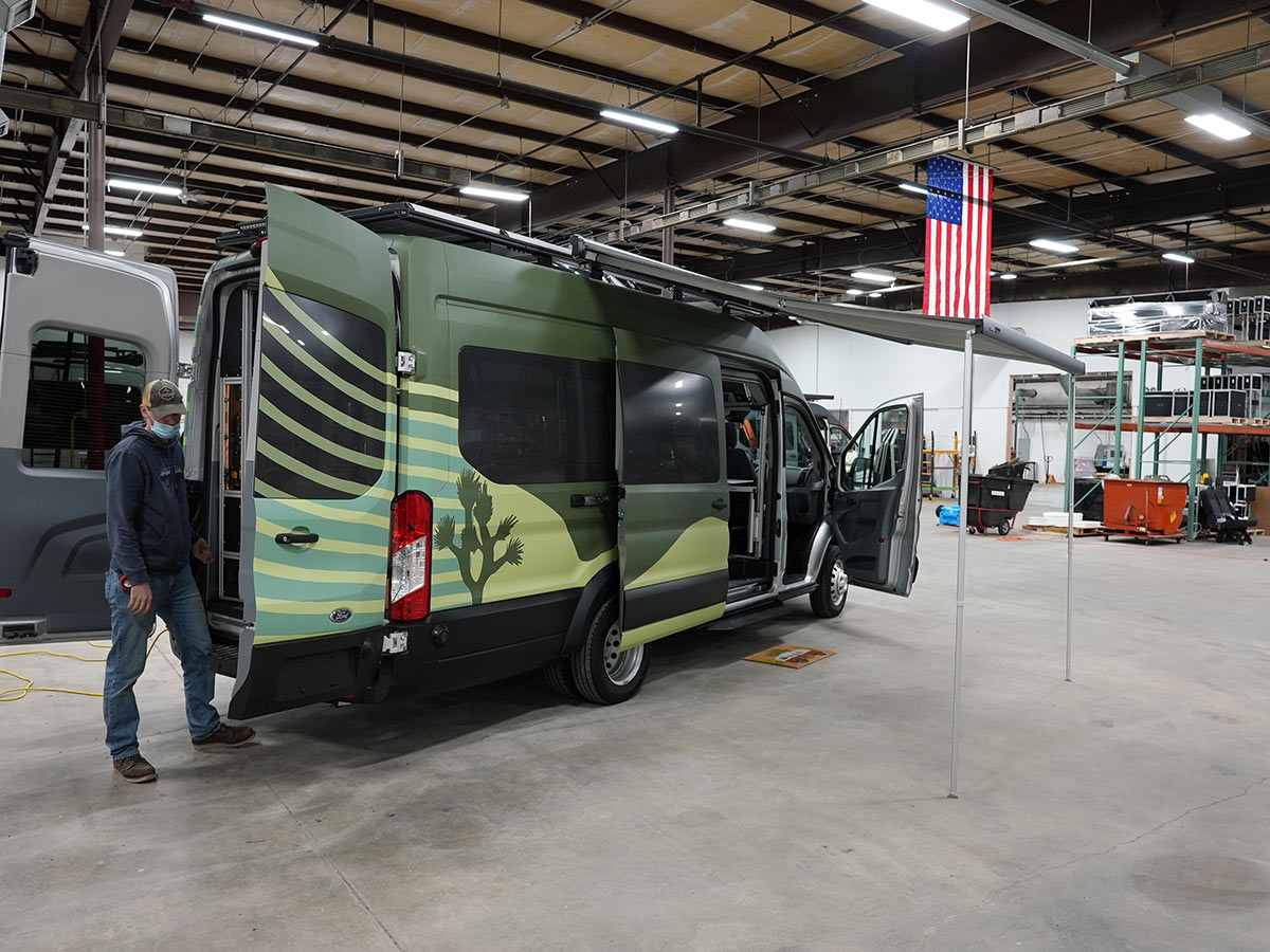 custom ford transit camper van with green vehicle wrap and graphics