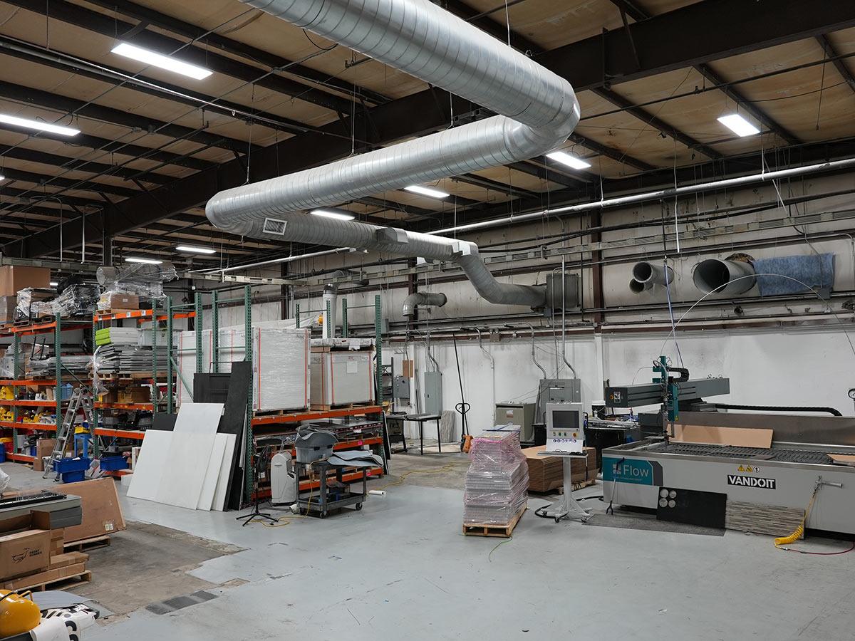 cutting room where vandoit makes custom floor panels and internal frames
