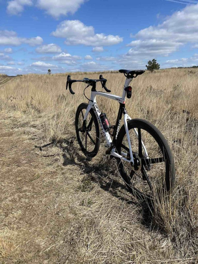 bikerumor pic of the day a pinarello bicycle is on a gravel path amidst golden grassy field with a blue sky dotted with fluffy white clouds in the Loenermark on the dutch veluwe.