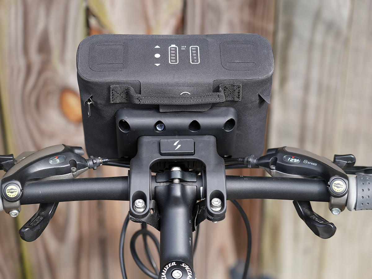 swytch e bike kit battery and control pack on a bicycle handlebar