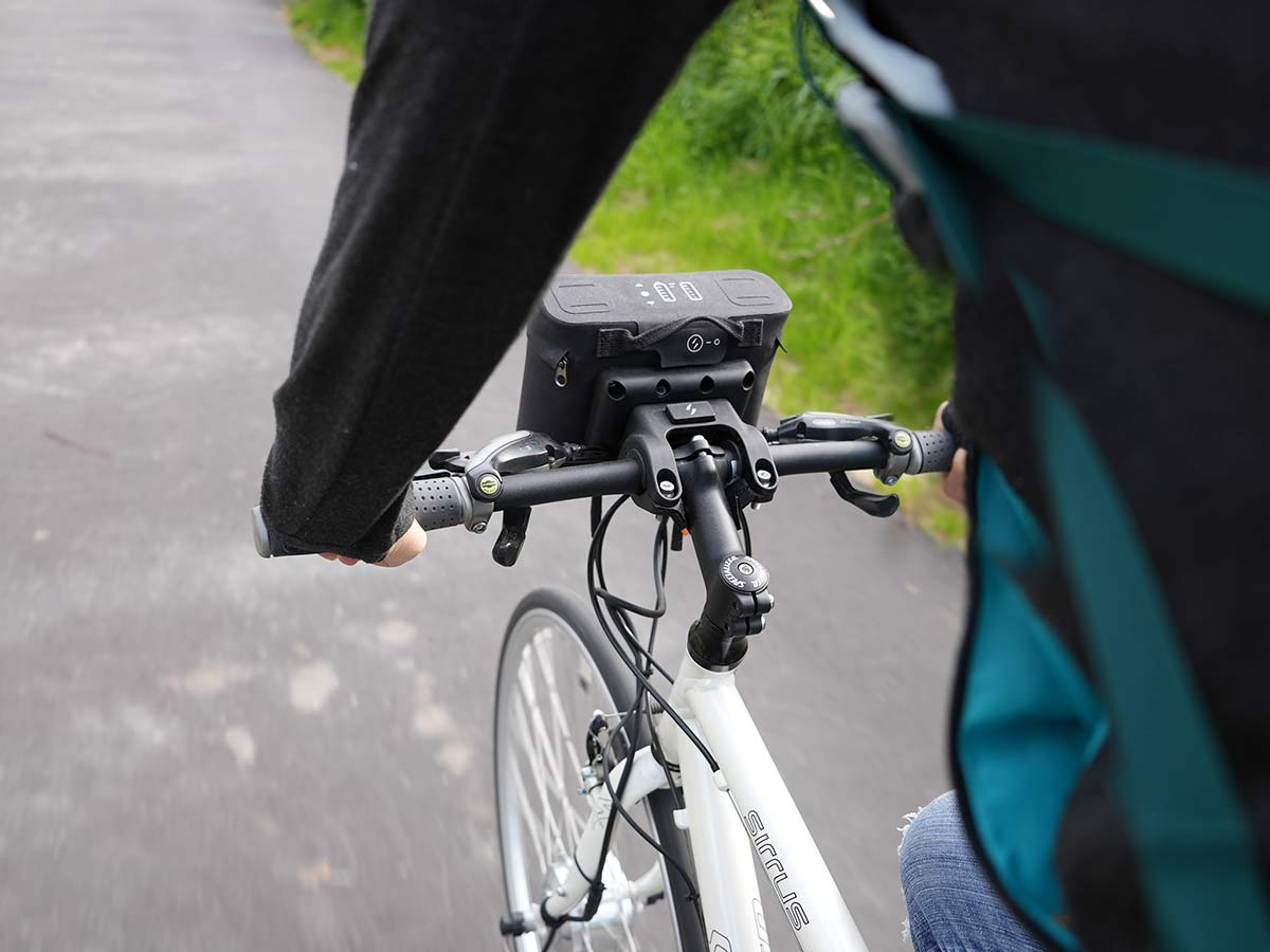 riding the swytch ebike conversion kit with front hub motor on a bike path