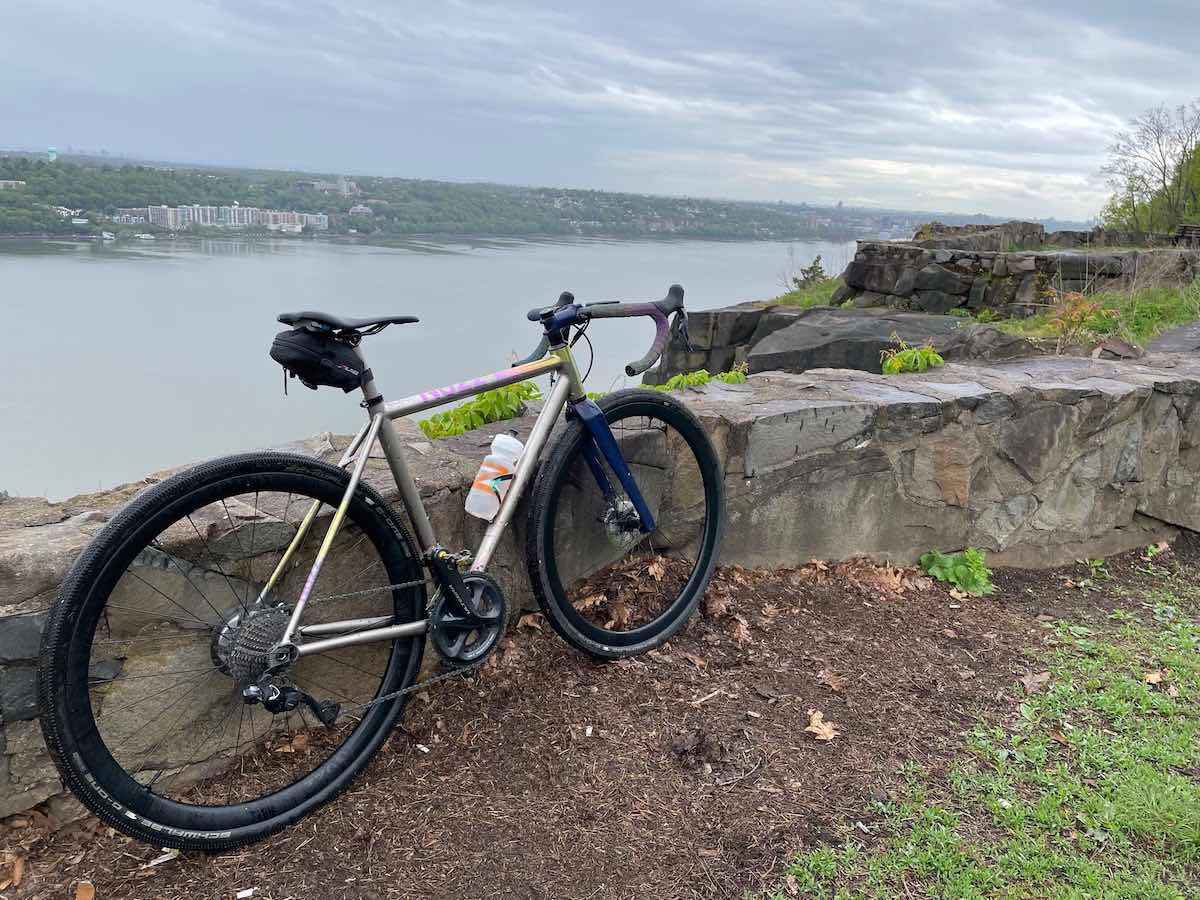 bikerumor pic of the day a no 22 drifter bicycle leans against a stone wall at palisades park overlooking a river with a small town on the other side.