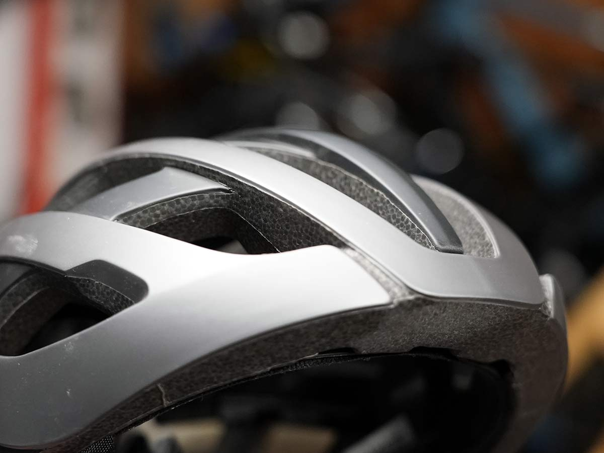 bicycle helmet closeup showing shell molded onto eps foam