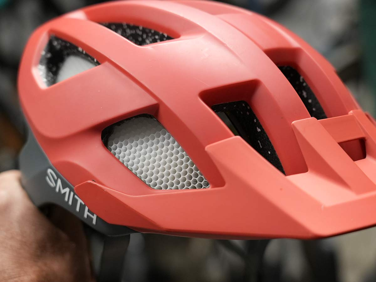 smith bicycle helmet with koroyd impact protection between the vents
