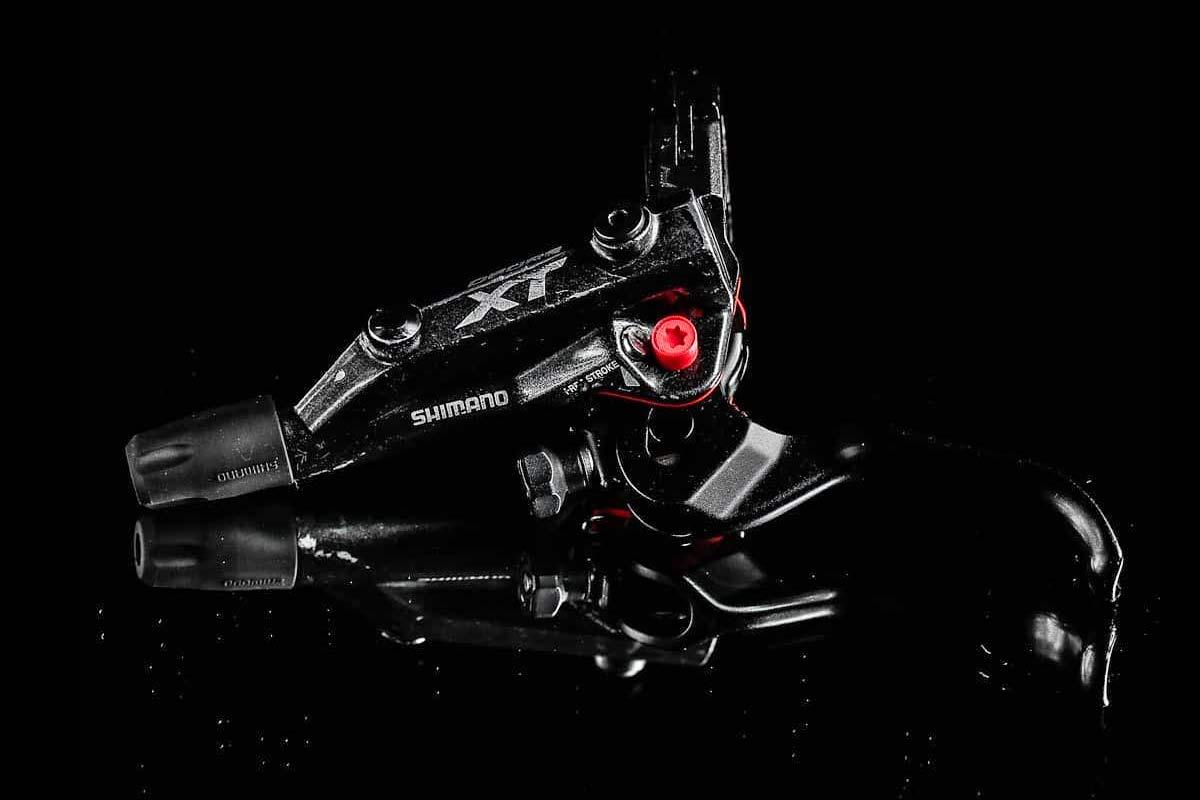 Red Panda Lobster red boot seal boosts Shimano MTB brakes - Bikerumor