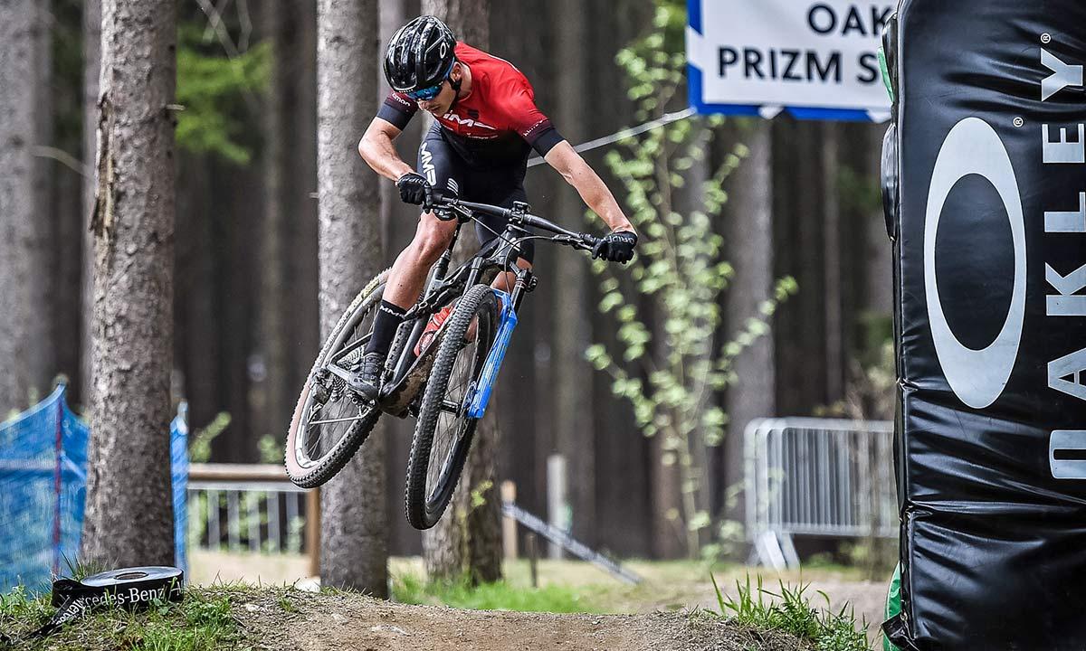 2021 MMR Kenta 29 prototype XC race bike, 100mm full-suspension carbon cross-country mountain bike, team MMR FRT jumping at Nove Mesto World Cup