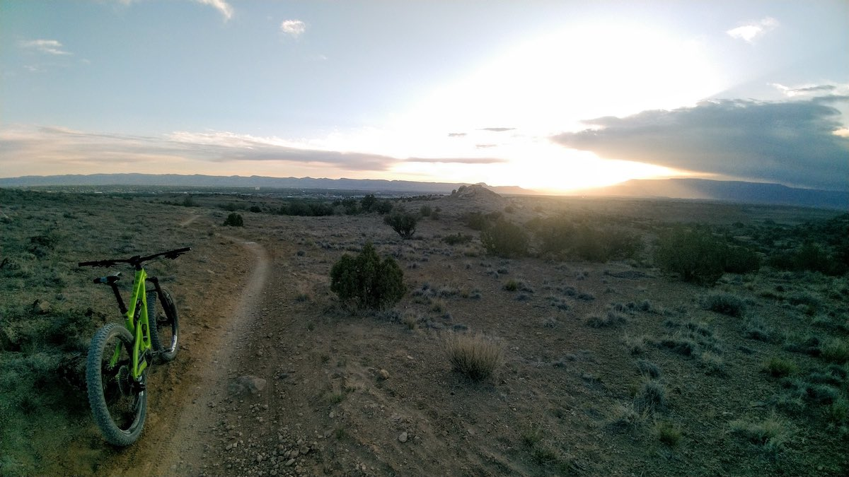 bikerumor pic of the day a bicycle is along a dirt path as the sun rises in grand junction colorado