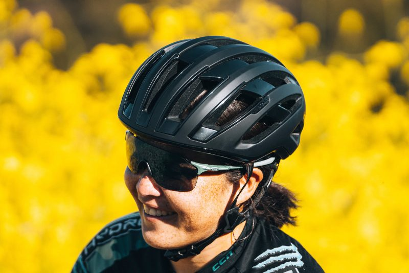 kali grit road and gravel bike helmet on a woman