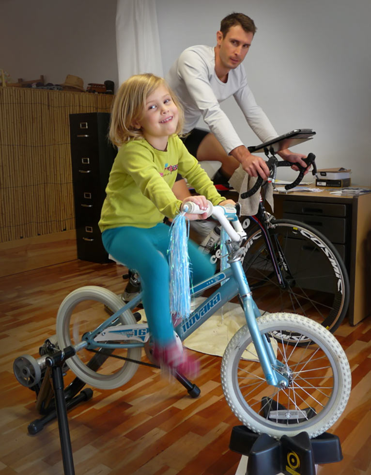 youngster riding a bicycle on indoor cycling trainer