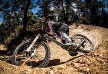 2022 mondraker summum carbon rr downhil bike being raced around a berm