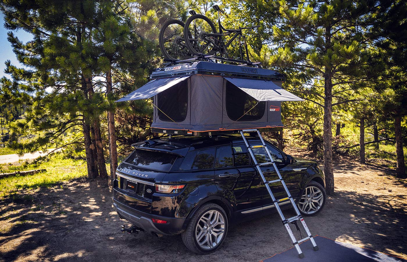 roofnest sparrow adventure rooftop tent with bike trays shown with tent open