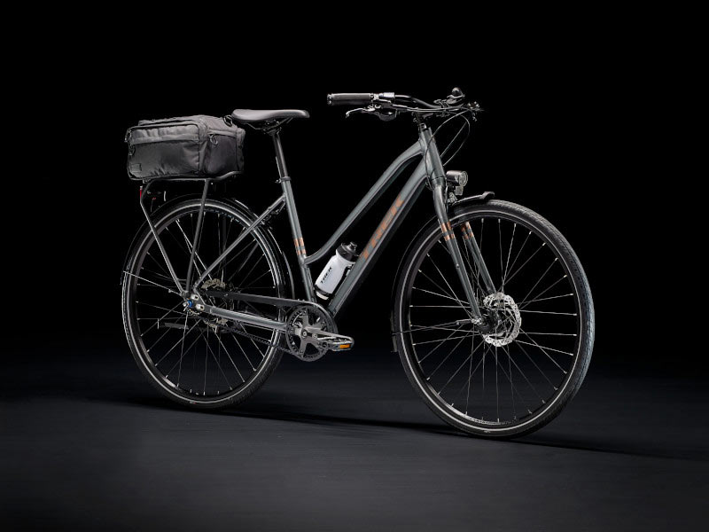 trek district step through commuter bike with rear rack and powered lights