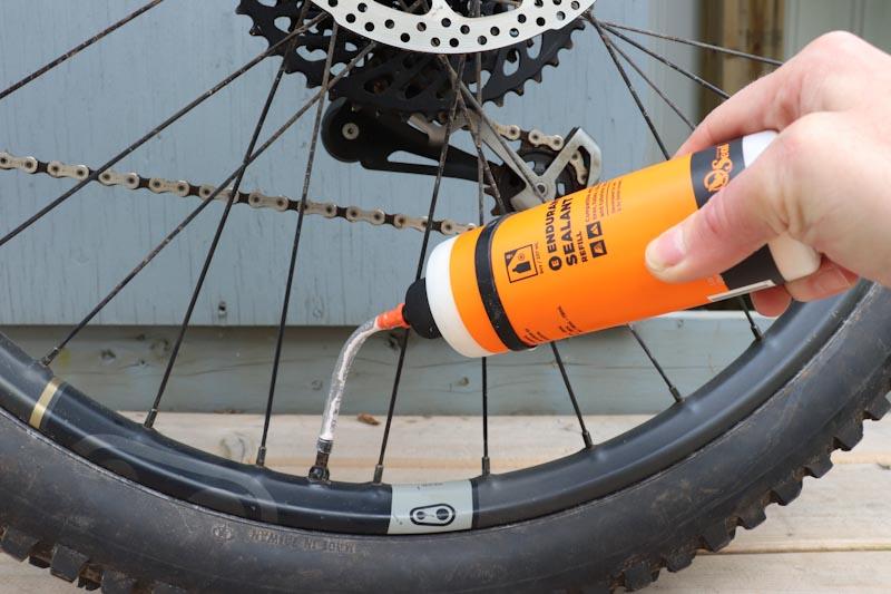 Orange Seal Endurance sealant, filling with hose