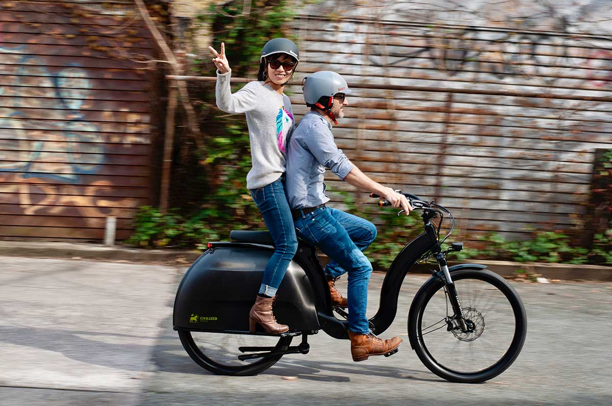 cicilized cycles model 1 ebike carrying passenger