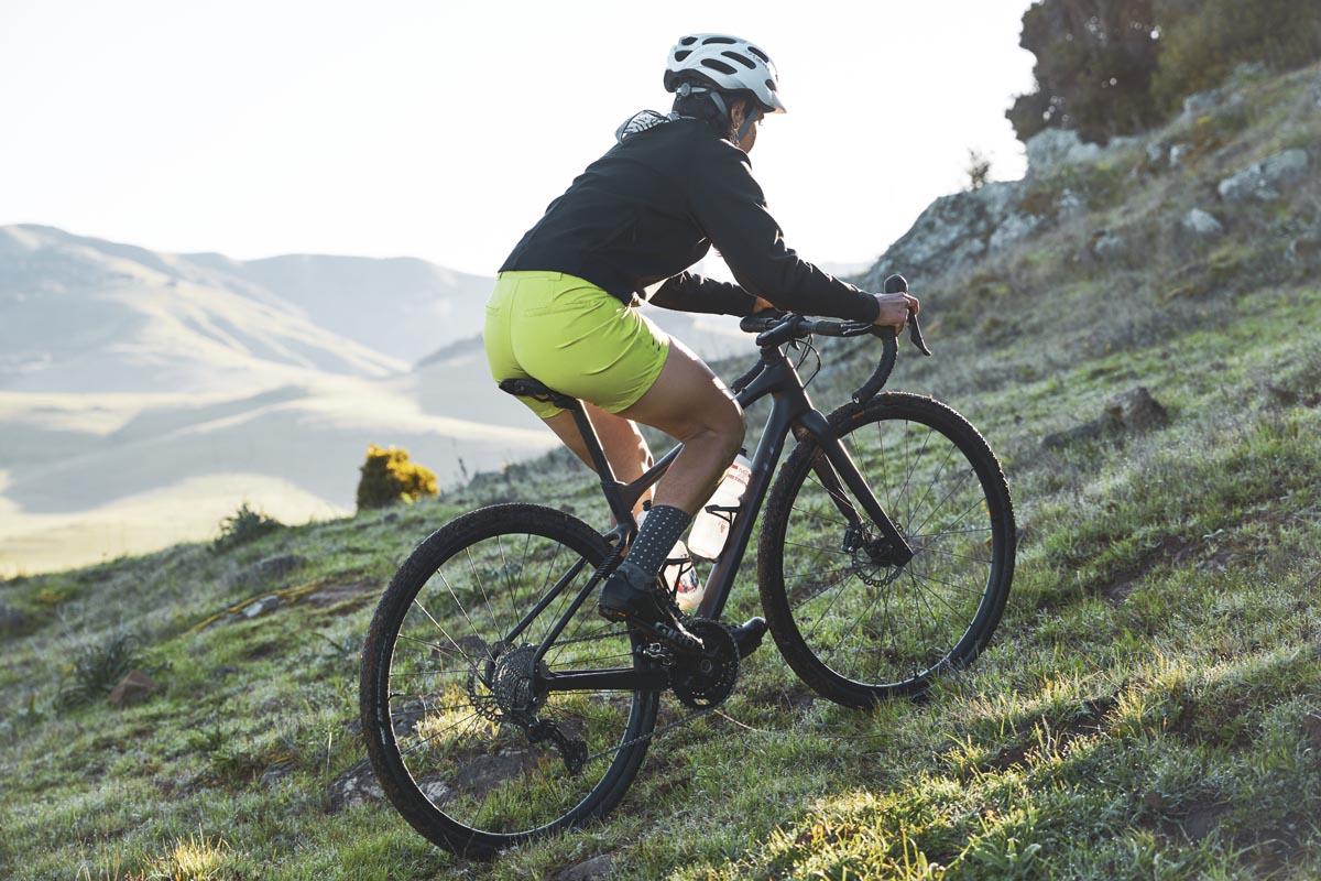 Machines for Freedom girl on bike climbing