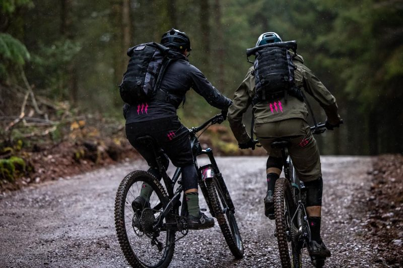 Muc-Off technical apparel, two riders