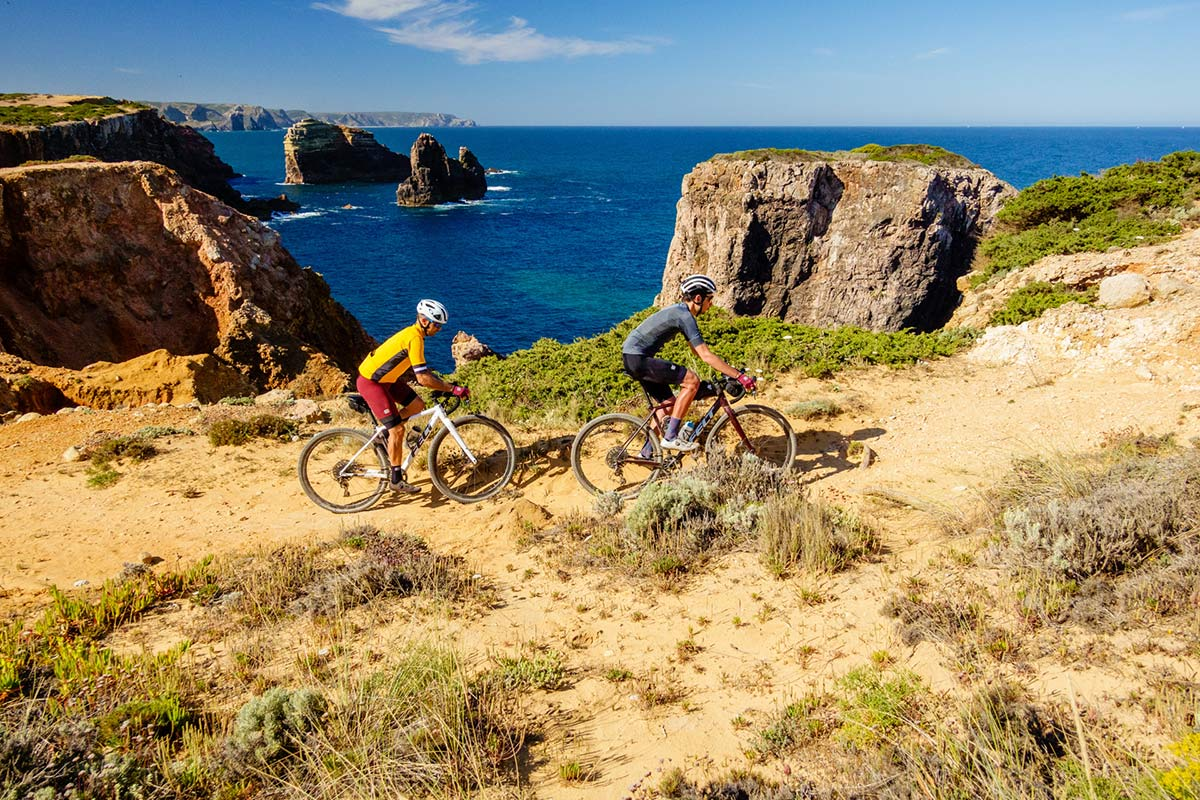 riding gravel bikes on rocky cliffs in portugal along the coast with thomson bike tours new off road trips