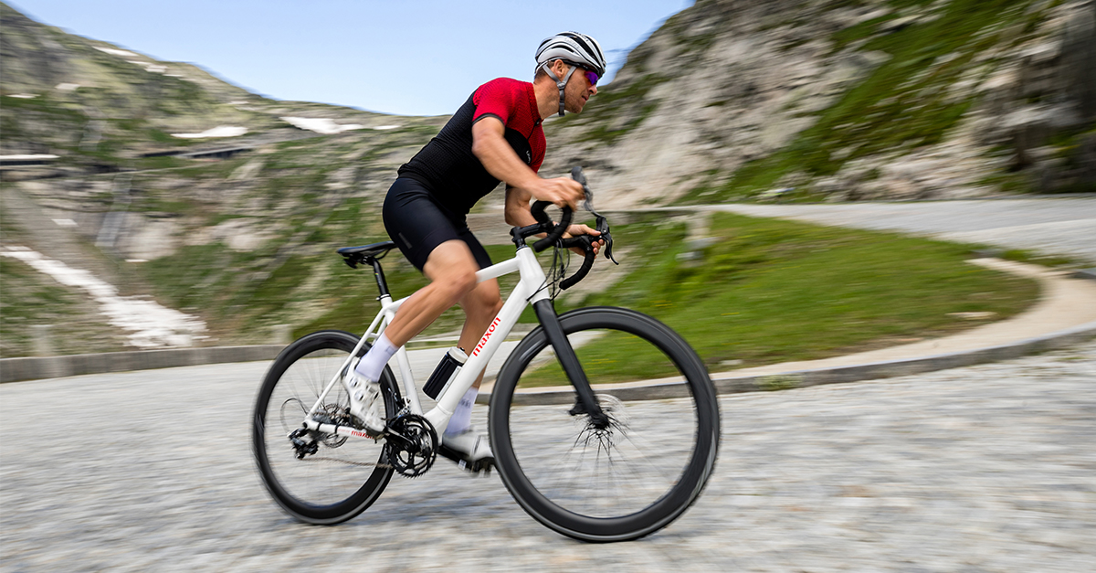 cyclist riding with maxon bikedrive air