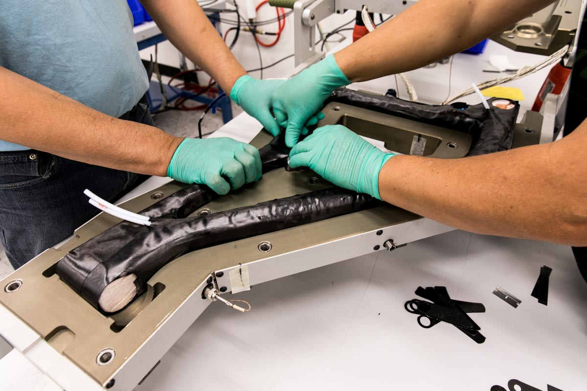 Ibis Exie frame being placed into a mold