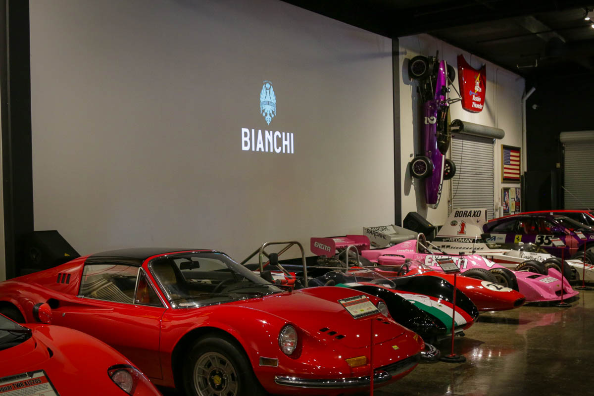 Bianchi behind sports cars and race cars