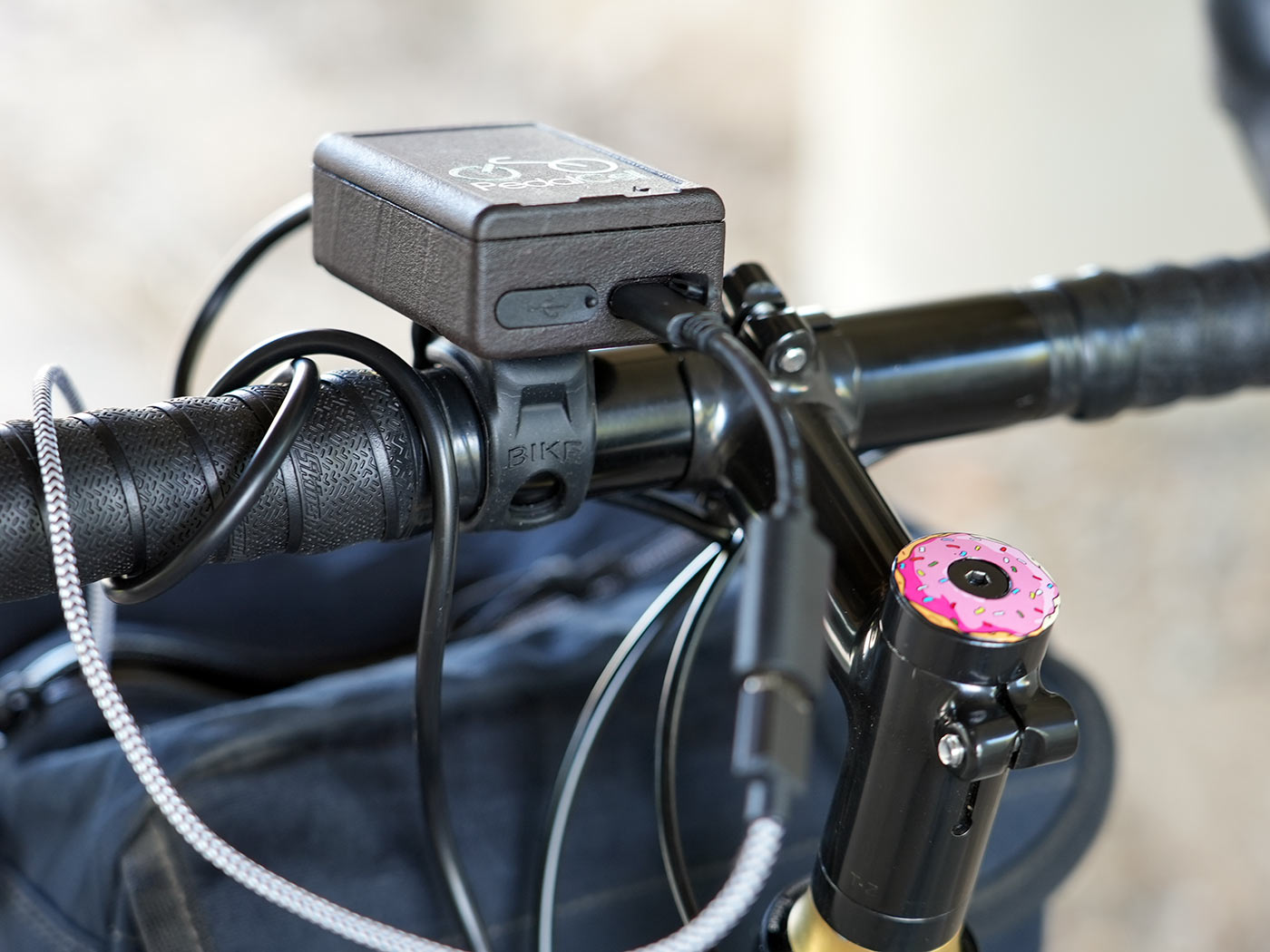 pedalcell bicycle dynamo control box with USB outlets shown on a handlebar