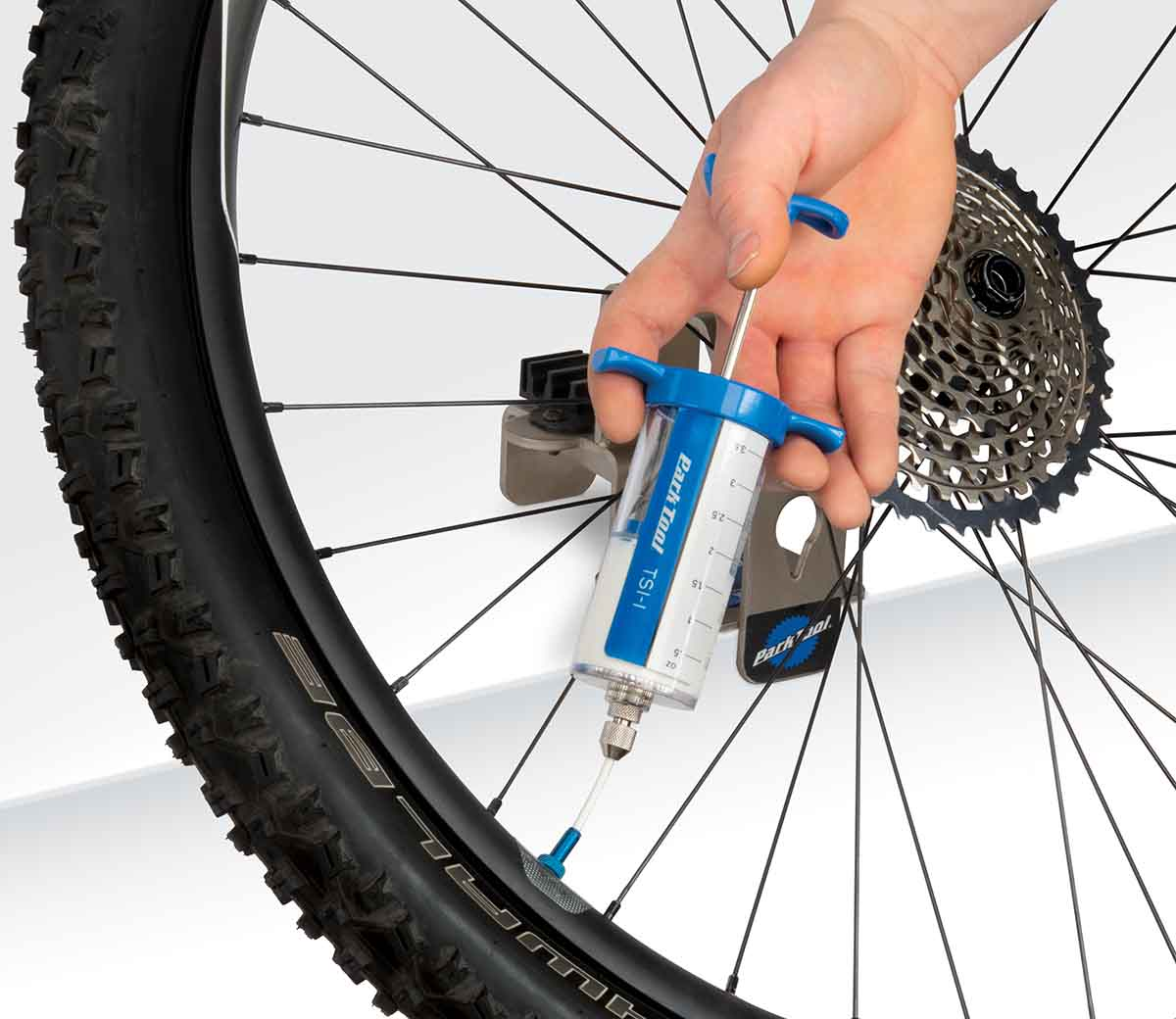 injecting tubeless sealant into a tire