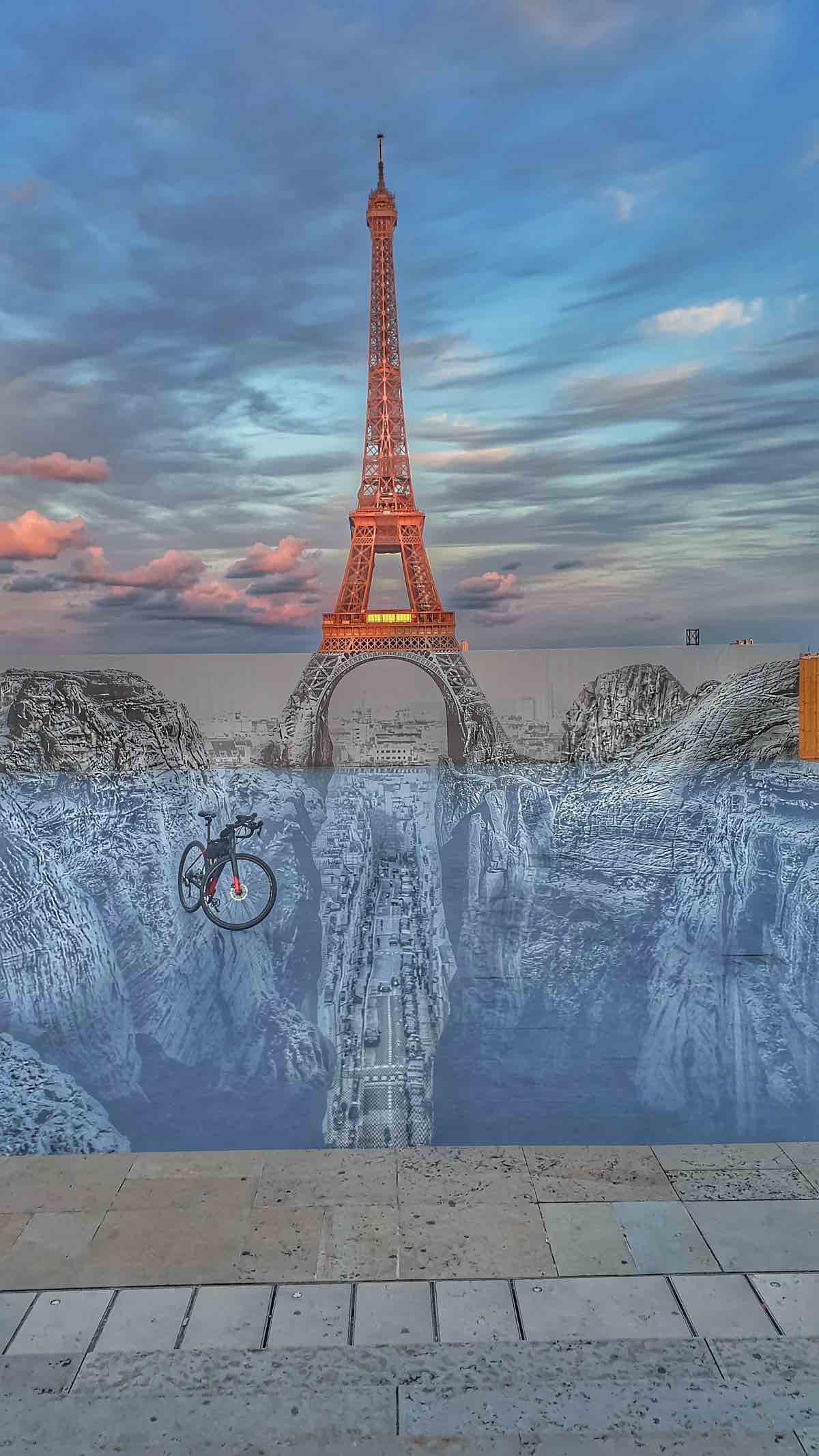 bikerumor pic of the day a specialized diverge seems to float above a scene anchored by the eiffel tower on street art created on the place du trocadero in paris france.