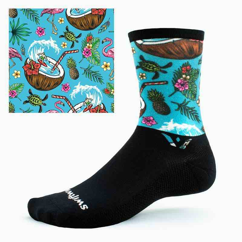 a black swiftwick cycling sock with a teal beach inspired print on the cuff.