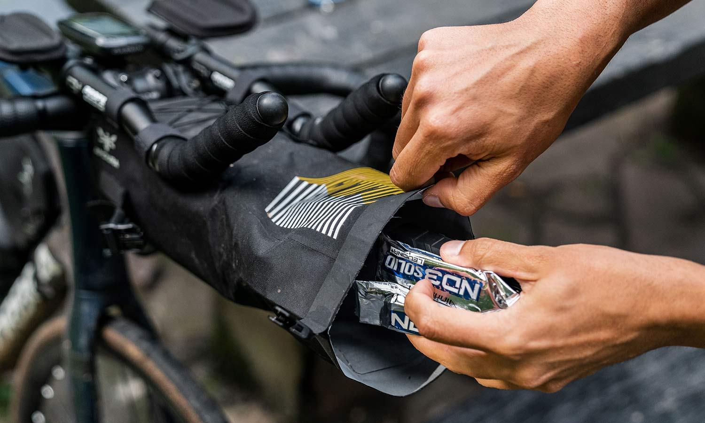 Apidura Racing Aerobar Pack out-front aero bar extension bikepacking bag, packing