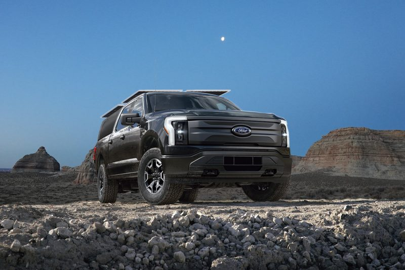 mockup of ford lightning f150 electric truck as an overland concept vehicle with rooftop solar