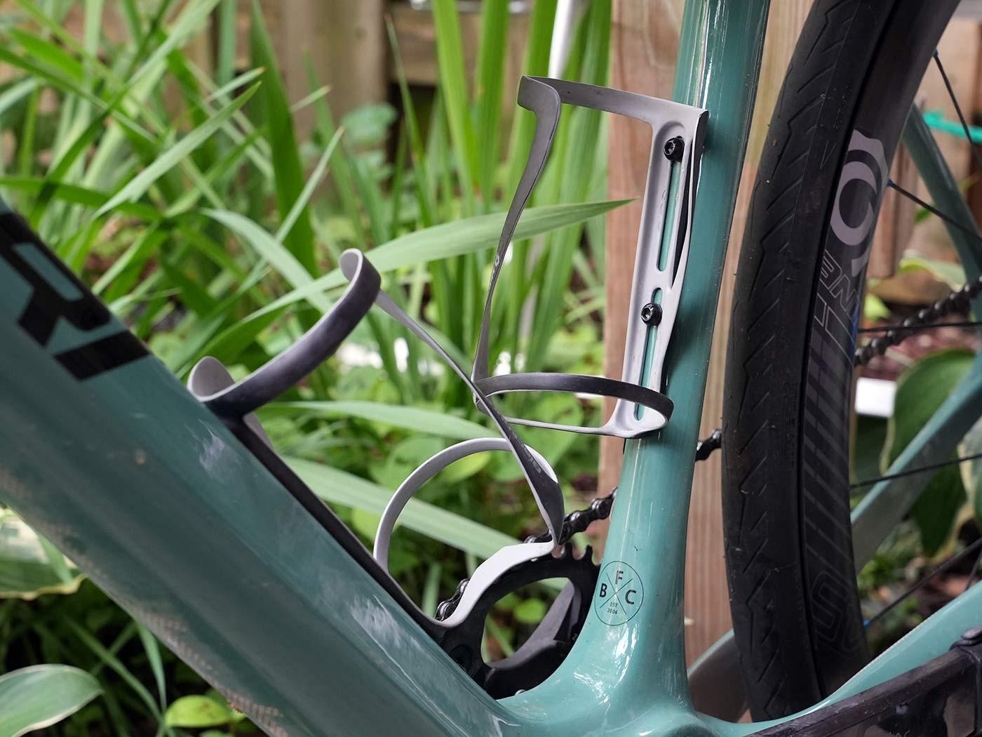 blackburn carbon fiber water bottle cages with huge adjustment range shown mounted on a bike